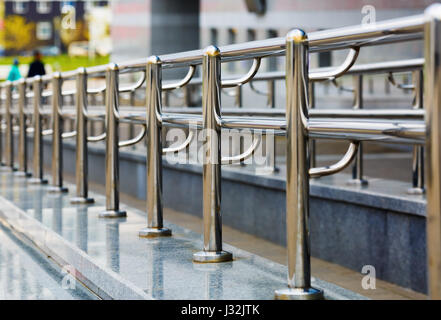 Chromium metal fence with handrail. Metal railings. Shallow depth of field. Selective focus. - Stock Photo