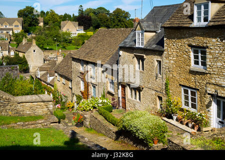 Picturesque cottages on Chipping Steps in summer sunshine, Tetbury, Cotswolds, Gloucestershire, UK - Stock Photo