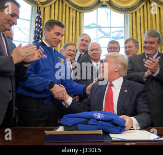 President Donald Trump, seated, shakes hands with NASA Astronaut Office Chief Chris Cassidy, after signing the NASA - Stock Photo