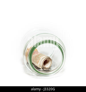 Old Greek money: Drachma coins and banknotes saved in a glass jar - Stock Photo