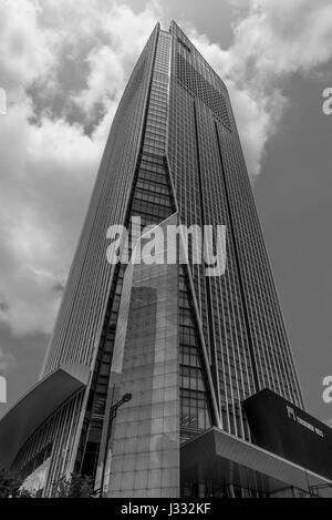 Street level View of Toranomon Hills Mori Tower. Located in Minato ward is the tallest building in Tokyo - Stock Photo