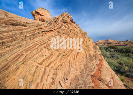 striped sandstone slickrock in the harris wash basin near escalante, utah - Stock Photo