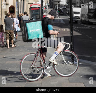 Deliveroo courier on bicycle in Newcastle upon Tyne. England, UK - Stock Photo