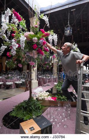 Man arranging large flower bouquet Los Apóstoles Bodega, Tio Pepe sherry bodega, González Byass, Jerez de la Frontera, - Stock Photo
