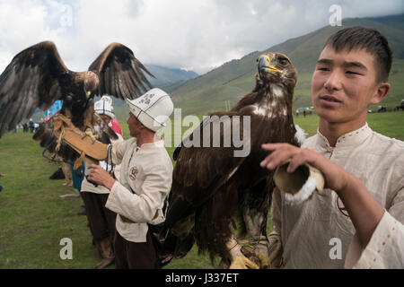 Azamat, a eagle hunter in the 11th grade from Bokonbayeva, Kyrgyzstan, takes part in the eagle hunting events at - Stock Photo