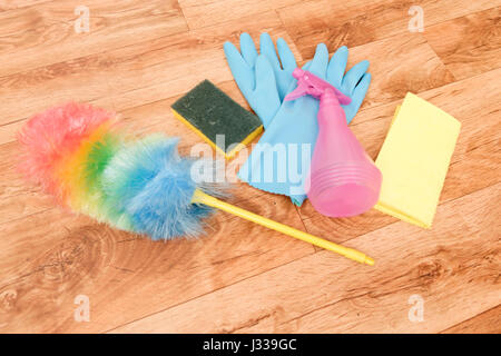 Cleaning tools on a parquet floor - Stock Photo