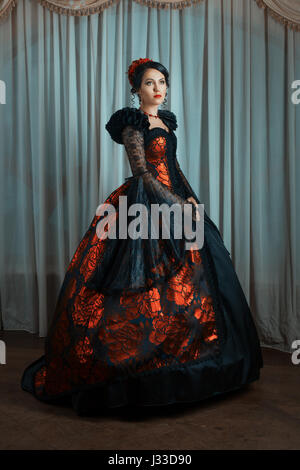 Renaissance Style - beautiful young woman in the lush expensive dress. Fashion. Vintage style. - Stock Photo