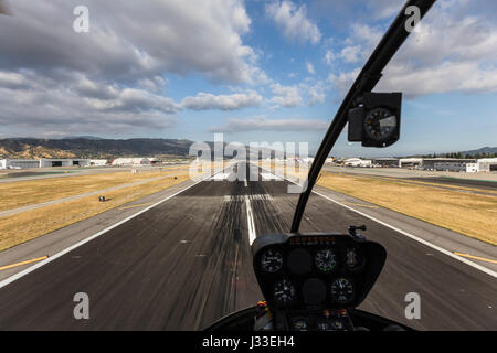 Burbank, California, USA - April 12, 2017:  Airport runway view with afternoon clouds in Southern California. - Stock Photo