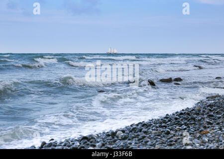 View over Baltic Sea to sailing ship on the horizon, Mons Klint, Klintholm, Mon island, Denmark - Stock Photo