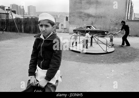 Asian boy playing children park Blackburn 1980s Lancashire UK HOMER SYKES - Stock Photo