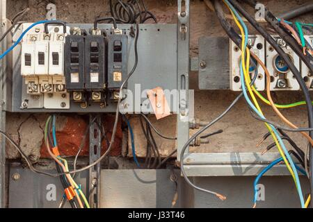 Repair of old electrical switchgear. An electrician replaces old ...