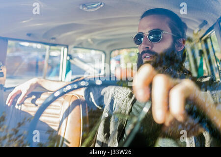 Handsome young man sitting in a car - Stock Photo