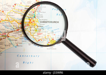 Map of New Zealand with magnifying glass focusing on Christchurch, North Island - Stock Photo