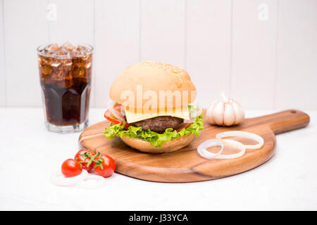 Homemade BBQ burger with coke on wooden background. - Stock Photo