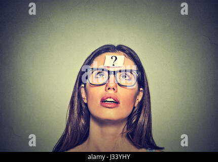 Thoughtful woman looking up - Stock Photo