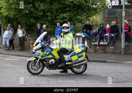 Police motorbike and rider controlling crowd - Stock Photo