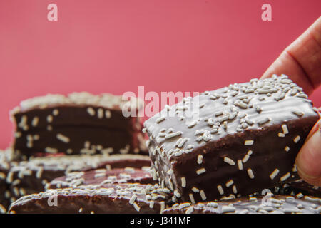 Desire for some brownie- just one....or maybe no - Stock Photo