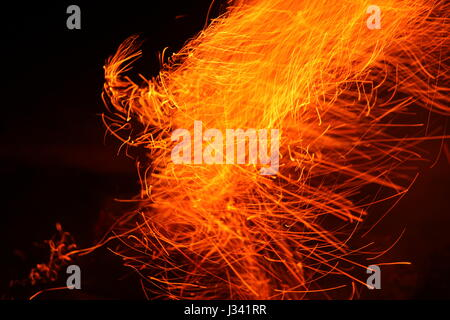 High resolution close-up of bonfire, with long exposure for the graphic effect of the sparks. - Stock Photo