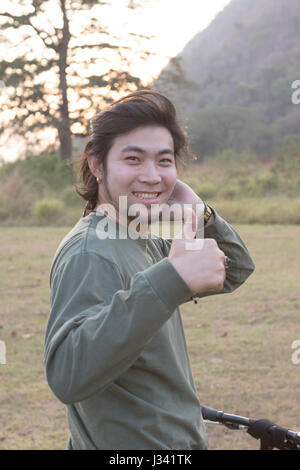 asian younger man toothy smiling face happiness emotion - Stock Photo