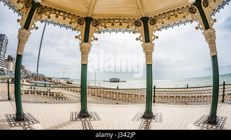 Fish eye view of the Victorian bandstand and the remains of the destroyed West pier in Brighton and Hove (UK) - Stock Photo
