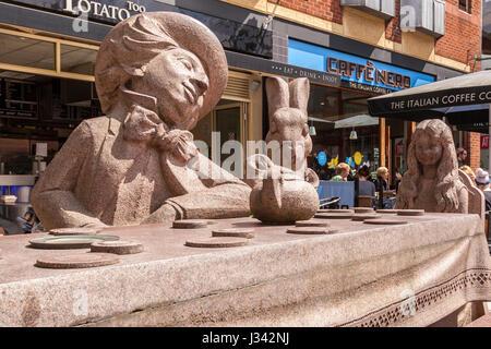 Alice in Wonderland statue in Golden Square. Warrington town centre. - Stock Photo