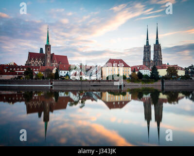 Wroclaw, Poland 22nd october 2016. Panoramic view of Ostrow Tumski in Wroclaw at sunrise with beautiful clouds in - Stock Photo