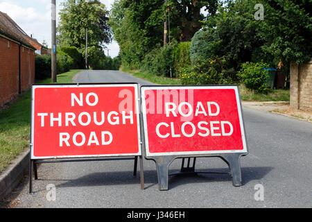 Road signs showing a street closed in the UK - Stock Photo