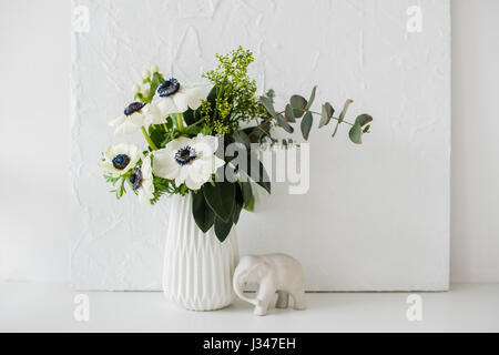 Elegant Bouquet Of Anemones In A Vase On Table In White Room Stock