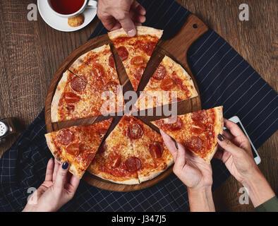 Flatlay. Friends eat pizza. - Stock Photo