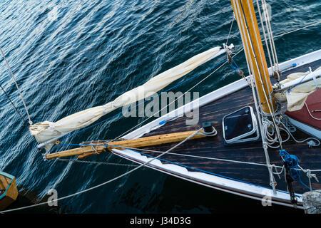 The bow of a small traditional sailing boat in Lunenburg, Nova Scotia, Canada. - Stock Photo