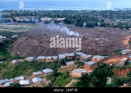 Dumping ground polluting environment in Pemba a port town and the capital of Cabo Delgado Province, on Mozambique's - Stock Photo