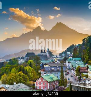 Mountain village of Berchtesgaden with Watzmann mountain silhouette in the background at sunset, Nationalpark Berchtesgadener - Stock Photo