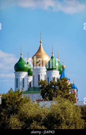 Kolomna domes of the assumption Cathedral on the Cathedral square among the trees on a Sunny summer day with clouds - Stock Photo