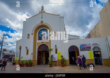COZUMEL, MEXICO - MARCH 23, 2017: San Miguel Church is full of turist that made lose their original atractive, procession - Stock Photo