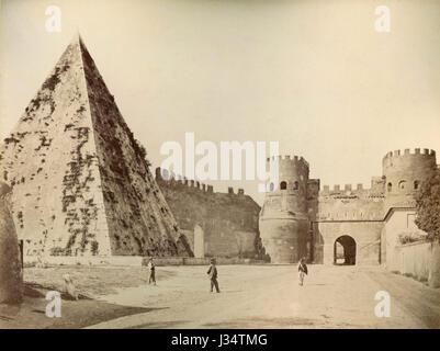 Pyramid of Cestius and Porta San Paolo, Rome, Italy - Stock Photo