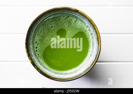 Green matcha tea in bowl. - Stock Photo