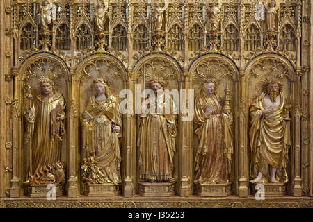 Saint Anthony, Saint Margaret the Virgin, saint king, Saint Barbara and Saint Judoc depicted from left to right - Stock Photo