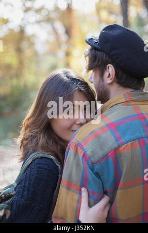 Portrait of a young couple embracing - Stock Photo