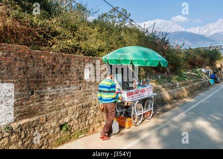 Local lifestyle: typical roadside street barrow stall outside Himachal Pradesh Cricket Association Stadium, Dharamshala, - Stock Photo