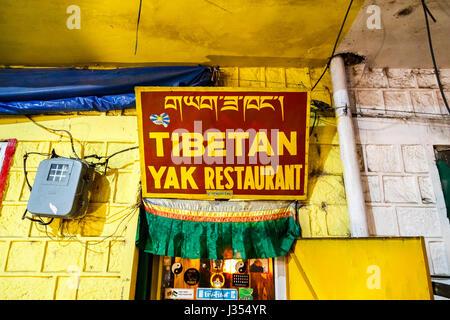 Sign at the entrance of popular local Tibetan Yak Restaurant serving traditional Tibetan food, McLeodGanj, Dharamshala, - Stock Photo