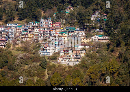 Typical mountainside houses and buildings on steep thickly wooded Himalayan hillside slopes, McLeodGanj, Dharamshala, Himachal Pradesh, north India