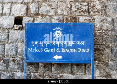Blue metal sign at Chonor House Hotel pointing to McLeod Ganj & Bhagsu Road, McLeodGanj, Dharamshala, Himachal Pradesh, - Stock Photo
