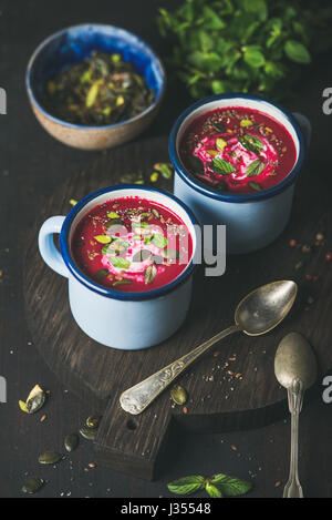 Detox vegetarian beetroot soup with mint, pistachio and seeds - Stock Photo