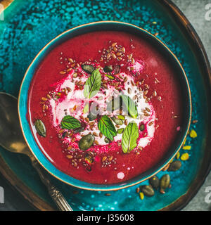 Beetroot vegetarian soup with mint, chia, flax and pumpkin seeds - Stock Photo