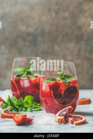 Blood orange and strawberry summer Sangria with mint and ice - Stock Photo