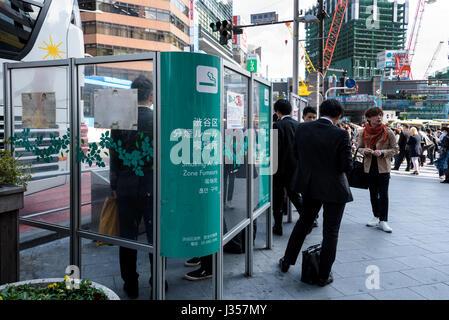 Segregated smoking area in a Tokyo street. - Stock Photo