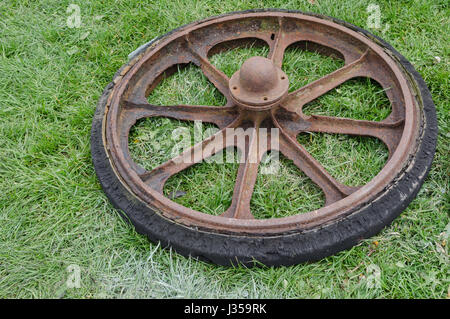 Old Metal Cart Wheel With Solid Rubber Tyre Stock Photo