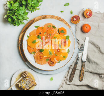 Fresh mixed citrus fruit salad with mint and honey - Stock Photo