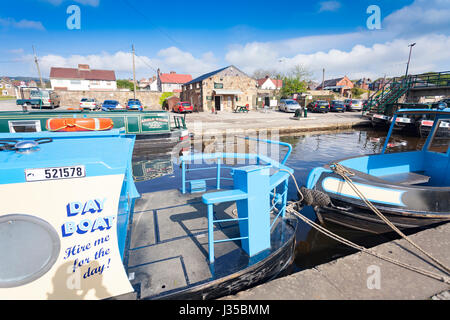 Trevor Basin and visitor centre in North Wales  on a blue sky day with day rental boats on the Llangollen canal - Stock Photo