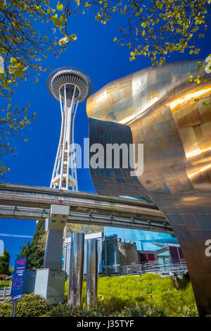 Space Needle and the Experience Music Project (EMP) building at Seattle Center. Seattle Center is a park and arts - Stock Photo